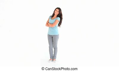 Isolated brunette standing up against a white background