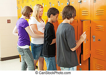 Teens at Lockers - Teenagers at their lockers between...