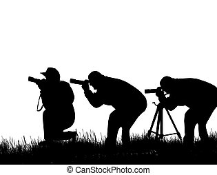 Three photographers - Silhouette of three photographers...