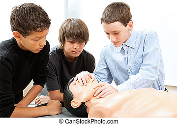 Boys Practicing CPR - Teenage boys learn CPR life saving...