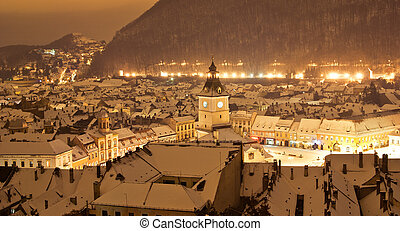 Brasov center in a winter night, Romania - Aeral view of...