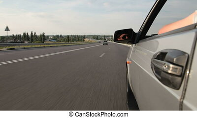 driving car - driving the car on the freeway Drivers face is...