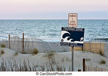 tsunami warning - tsunami zone warning sign on the beach