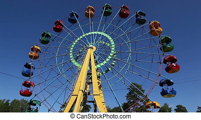 Carousel - Ferris wheel in the park