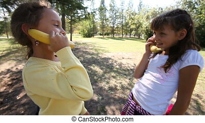 Banana phone - Two girls pretending to talk on the phone...