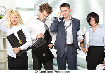 Hard day - Group of tired and annoyed businesspeople after...
