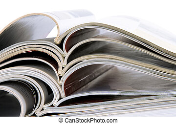 Pile of magazines with bending pages