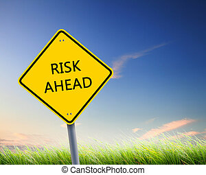 road sign of risk ahead - yellow road sign as a warning of...
