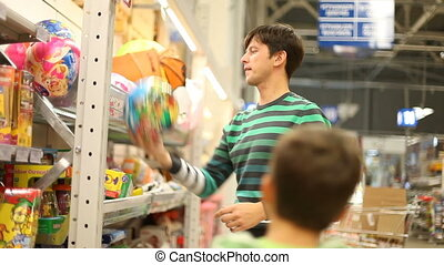 Ball test - Father and son in the supermarket choosing balls...