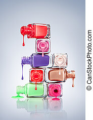 Nail Polish. - Nail polish dripping from stacked bottles.