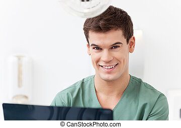 Young dental assistant smiling - Close-up portrait of young...