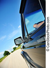 rural road. - Driving along at car on rural road.