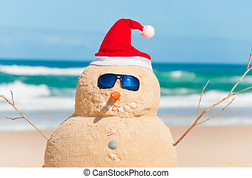 Snowman Made Out Of Sand With Santa Hat - Snowman On Beach...