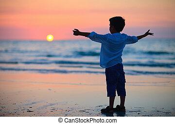 Little boy at sunset