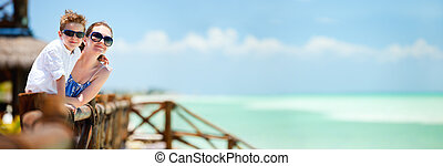 Mother and son on vacation - Panoramic photo of mother and...