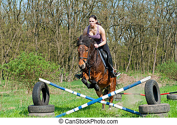 Equestrian - Horse Jumping - Pretty girl and bay horse...