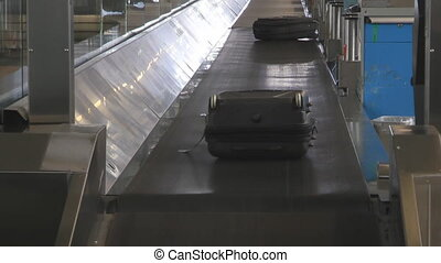 Airport Suitcases - Checked Luggage On A Conveyor Belt At...
