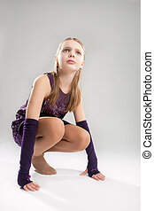 ready for action - little caucasian blond girl sitting on...