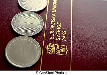 passport and coins - swedish pasport from the EU and coins