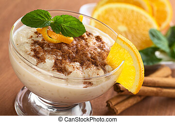 Delicious homemade rice pudding with cinnamon garnished with...