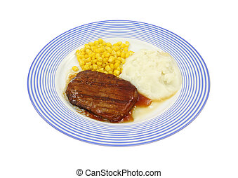 Salisbury steak dinner on blue plate - Freshly cooked...