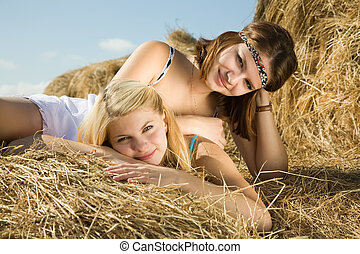 girls laying on hay - country girls laying on hay bail at...
