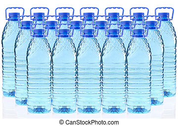 plastic bottles of mineral water in a three row