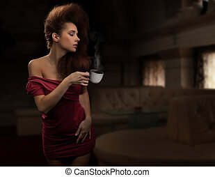 Sexy woman holding cup of tea