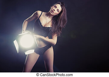 Sexy woman with lamp
