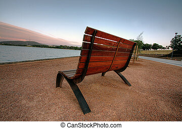 bench in canberra - a bench in canberra at sunrise