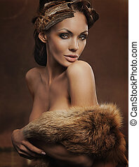 portrait of a beautiful woman wearing fur