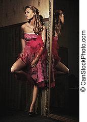 Pin up girl wearing pink dress