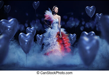 Young woman in the mist with hearts
