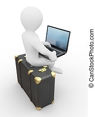 Man with laptop on the luggage