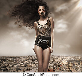Fresh young beauty over cityscape background