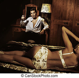 Handsome man with glass of wine with smiling girl in...
