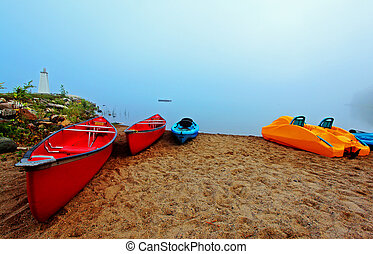 canoes and kayaks at sunrise - canoes and kayaks in early...