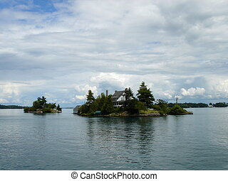 Island with a house on Ontario lake, Canada - Small island...