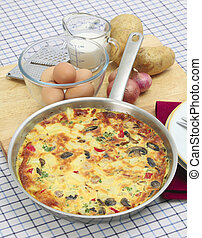 Spanish omelet tortilla vertical - A freshly cooked Spanish...