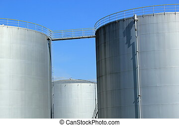 Oil tanks - Big grey oil tanks and blue sky