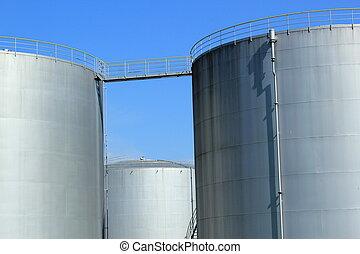 Oil tanks - Big grey oil tanks and blue sky