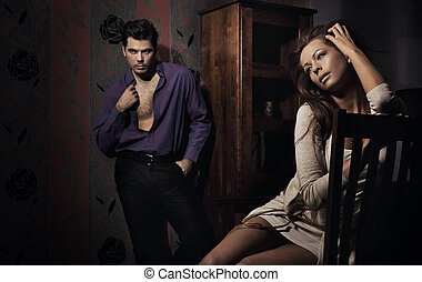 Photo of amazing young couple in nice room