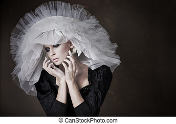 Great portrait of pretty young blonde with white hat
