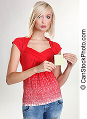 Portrair of blonde pretty girl holding an empty paper