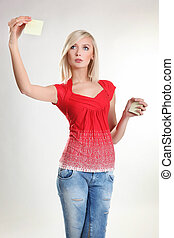 Photo of cute young woman holding an empty paper