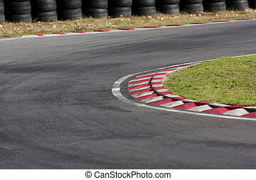 Empty tarmac race track corner - An empty bend on a race car...
