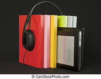 Audiobooks concept - Colorful books with headphones and...