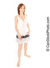 Portrait of a beautiful woman in summer dress