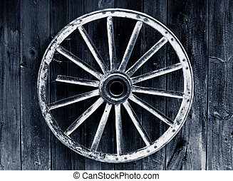 rustic wagon wheel hanging on a wall