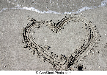 Sand Heart - Romantic Heart drawn in the sand at the shore...